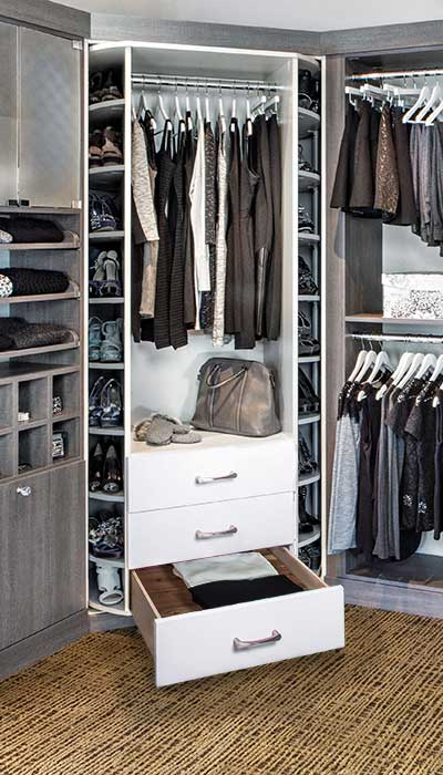 Very tiny walk-in closet with custom closet organizers for small closet storage.