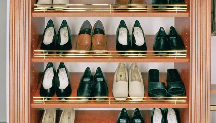 slanted shoe shelves with fences for closet organization