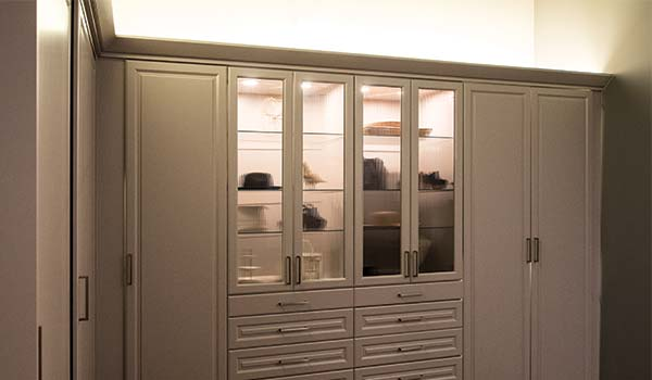 Above cabinet LED lighting for illuminating areas above closet or pantry system