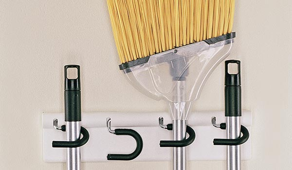 Broom And Mop Holder For Up To Four Stick Tools