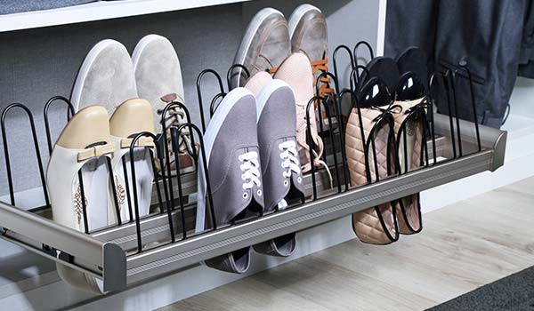 Closet accessory shoe organizer slides out from custom closet system and holds 8 pairs of shoes