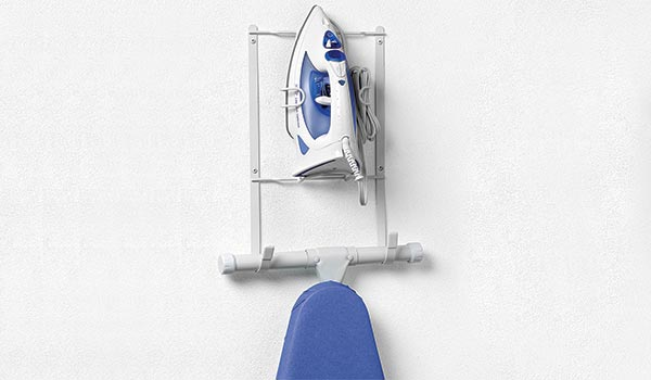 behind the door ironing board and steam iron holder