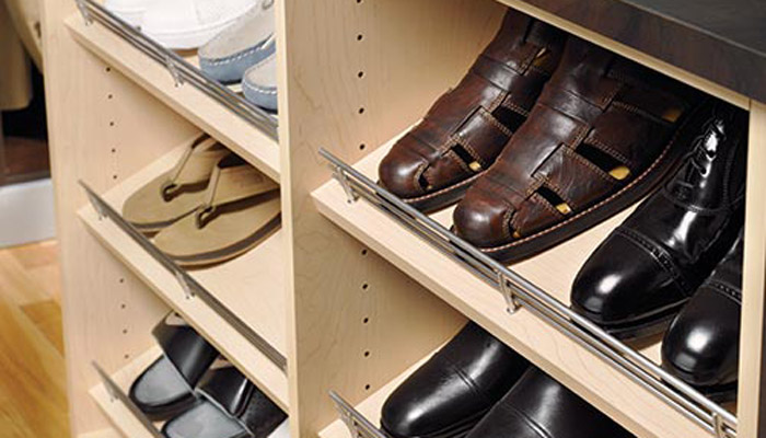 slanted shelves with shoe fences for closet