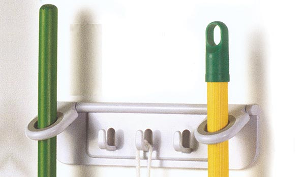 Broom and mop holder includes two stick tool hangers and three hooks