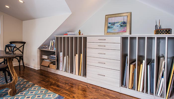 Custom Wall Unit Art Storage Is Ed Under The Eaves And Sloping Roof