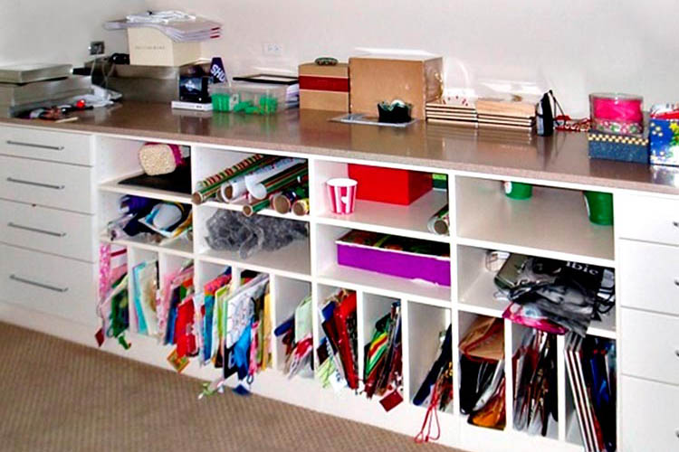 Craft room organizers for gift wrap room and craft studio for Craft wall storage system