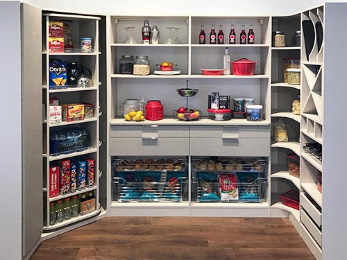 When designing a pantry rotating storage is great for pantry corners