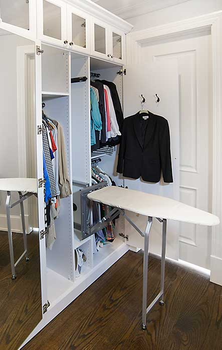 cabinet style built-in ironing board folds up when not in use