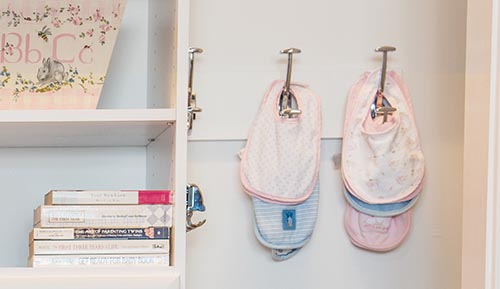 organize baby bibs with hooks