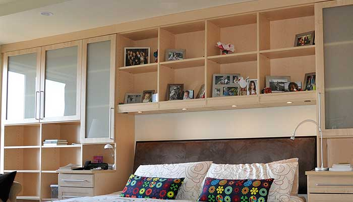 surround head of bed with built-in shelves and cabinets