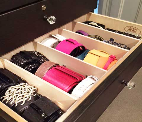 belts organized in a drawer