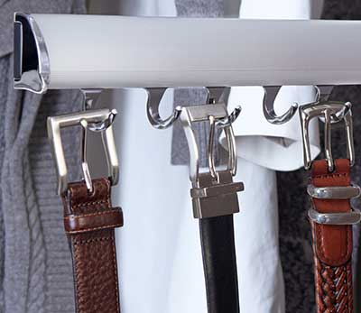 closet remodeling shows belts on rack