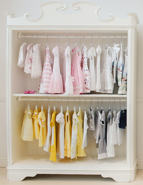 A bookcase can be turned into a simple closet for a baby