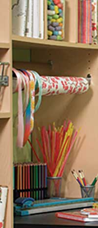 Tilt hamper from the closet make a great organizer for rolls of paper