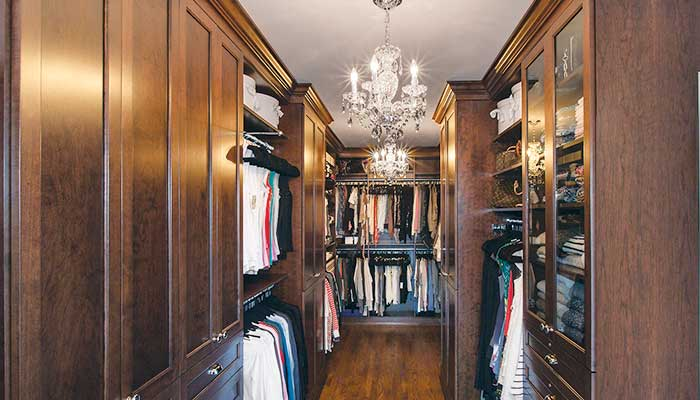 Closet with closet cabinet doors in wood and glass