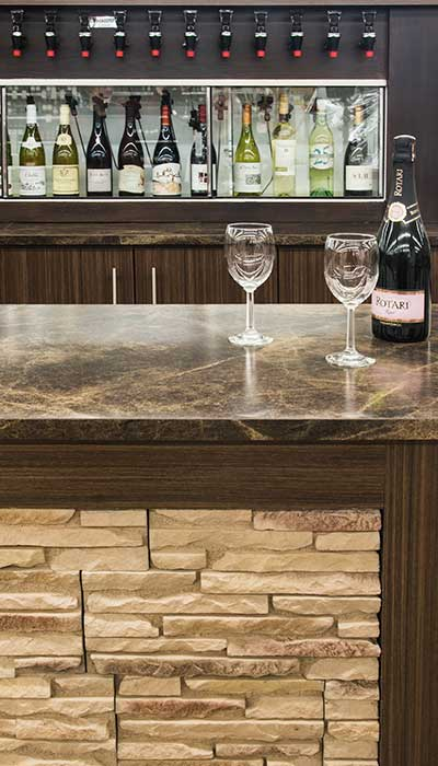 Custom wine cabinetry with cruvenit and commercial bar for wine tasting at a liquor business