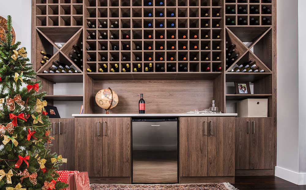 A wine and beverage center can help you stay organized during parties. This one offers wine storage in the upper cubbies with a refrigerator that holds drinks for the kids below.