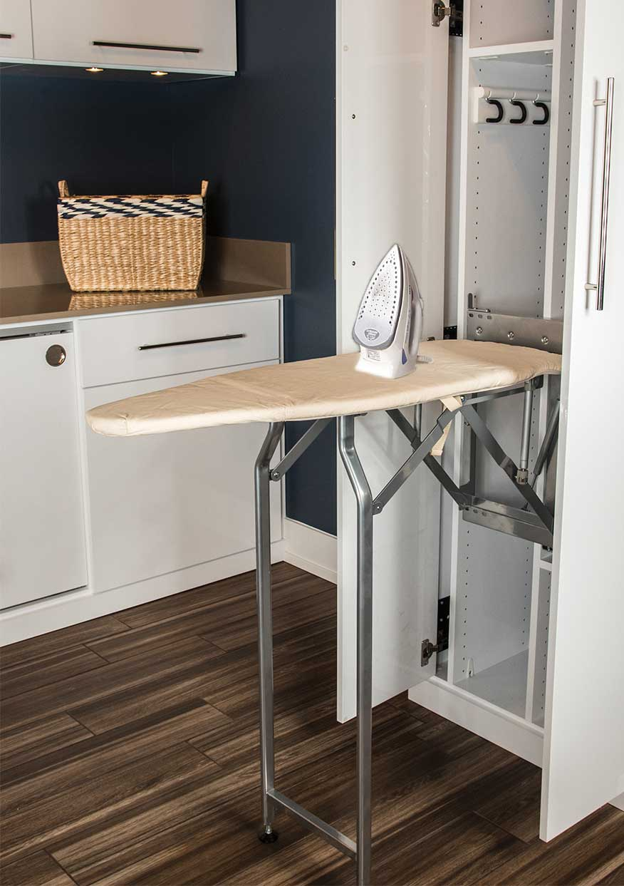 cabinet style built-in ironing board for a laundry room