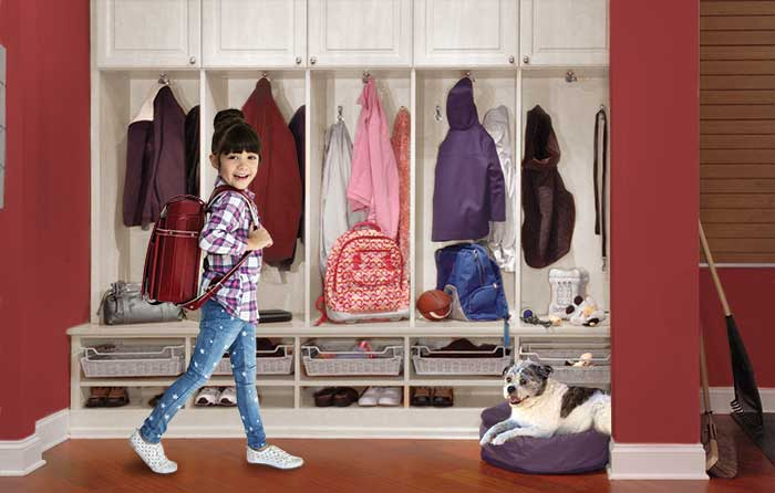 An organized mudroom aids back to school preparation for child