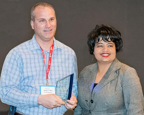 Greg Cetera is presented with award by Michelle Bradford of Woodworking Network