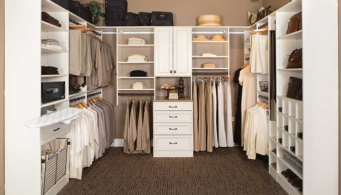 Clutter free walk-in closet with custom organizers