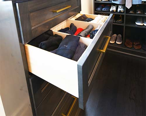 organized closet drawer with dividers