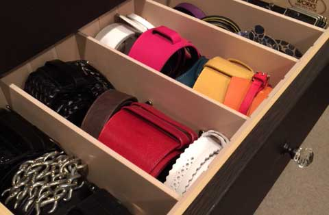 belts stored rolled in a closet drawer with custom drawer dividers