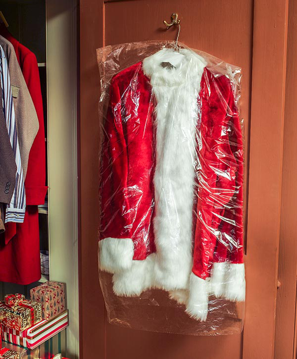 Dry cleaned Santa suit in closet