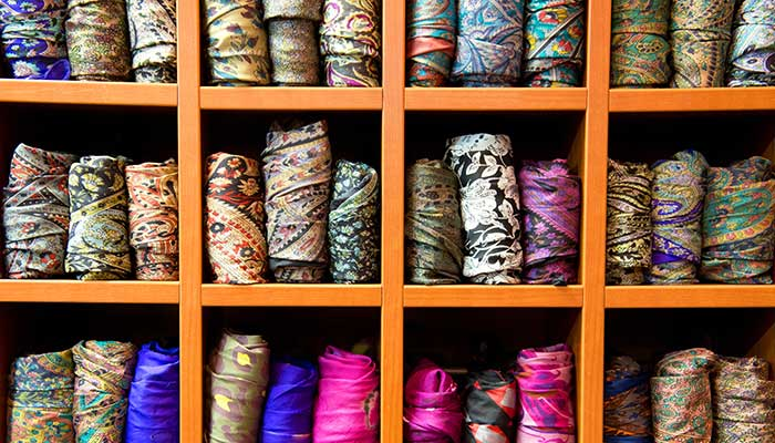 colorful scarves organized in shoe cubbies