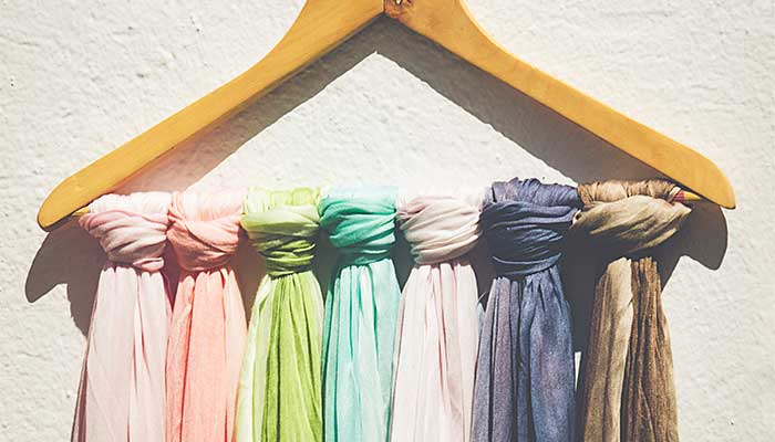 Scarves organized on hanger