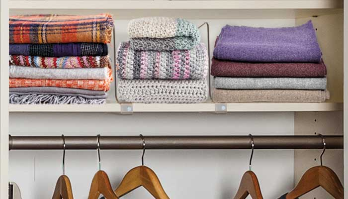 Scarves organized on shelves