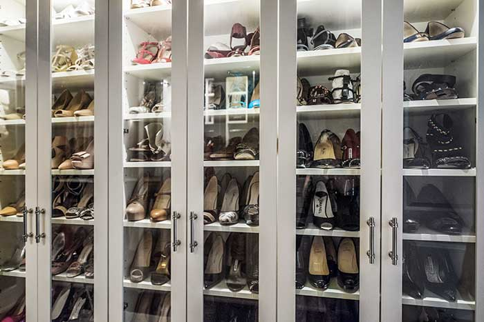 large shoe cabinet with glass doors