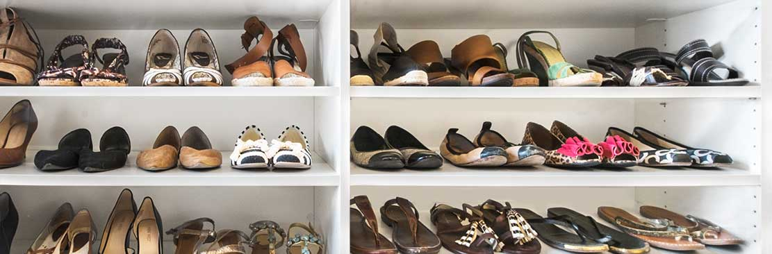 Six shelves of womens shoes from a shoe closet.