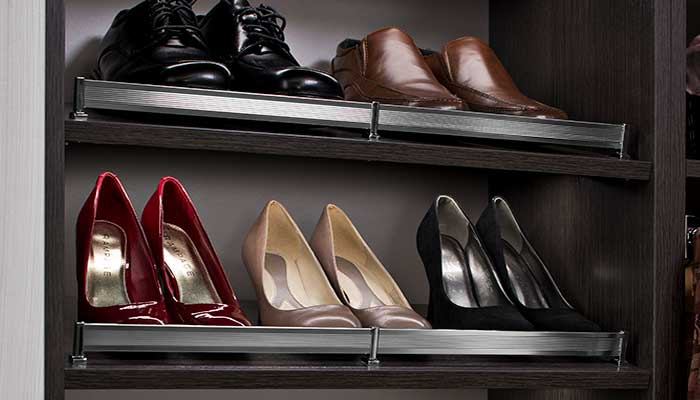 slanted shoe shelves with shoe shelf fences to keep shoes in place