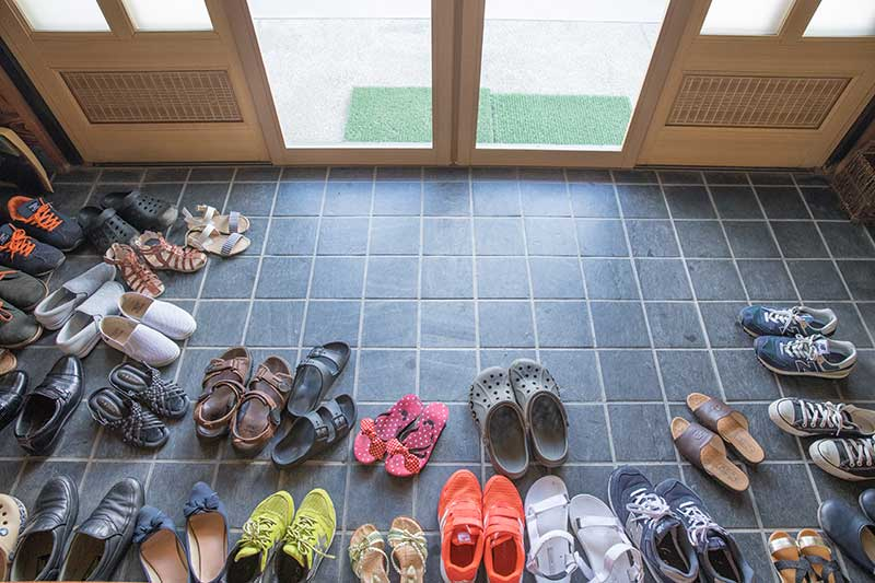 shoes by door of home