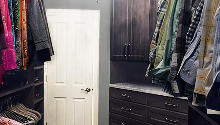Master walk-in closet with severely angled walls