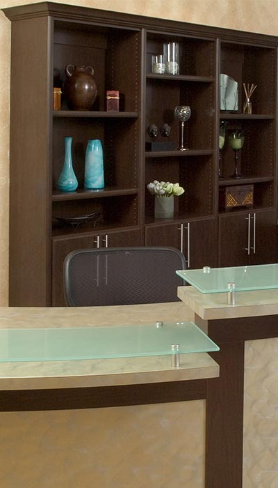 custom wall unit office supply storage behind receptionist desk
