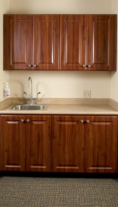 sink area and office cabinets designed for medical office