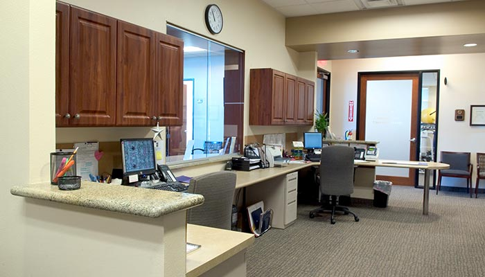 office design with receptionist desk and work area for medical offices