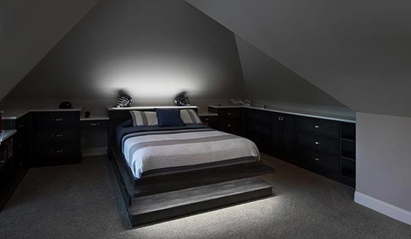 Custom bedroom furniture with LED closet lights fixtures for room with slanted ceiling