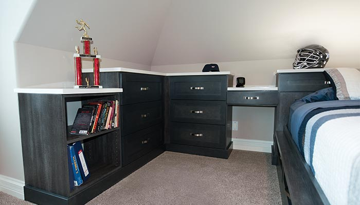 custom storage system and bed for sloped walls