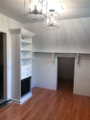 custom walk in closet for sloped ceiling room