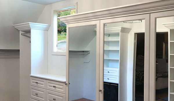 walk in closet and dressing room for sloped ceiling room