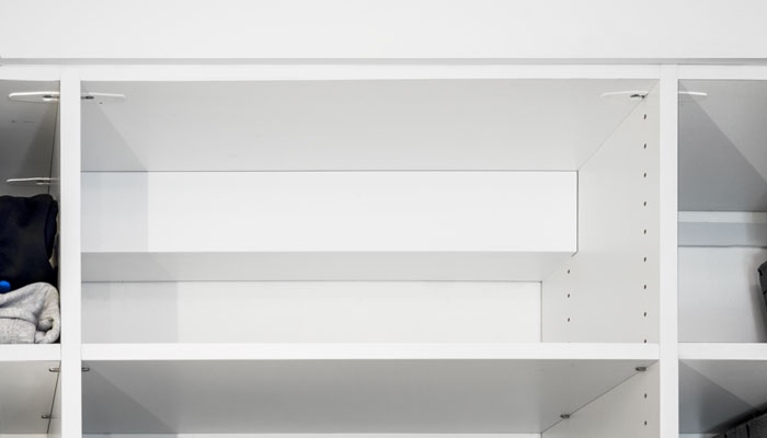 Custom cover in closet hides electrical components