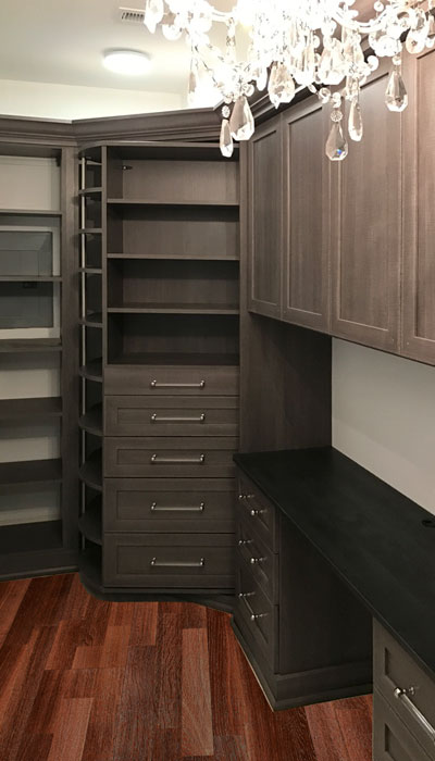 custom walk in closet organization system with bella doors
