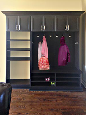 mud room design adds closet organization system to the rear entrance