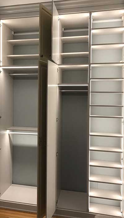 Custom wardrobe closet featuring lots of small closet lighting ideas