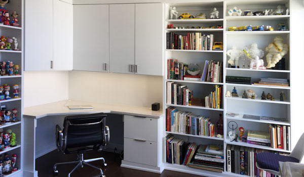 guest room to office with memorabilia storage ideas