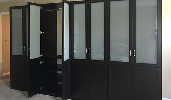 custom master bedroom wardrobe closets with frosted glass inserts