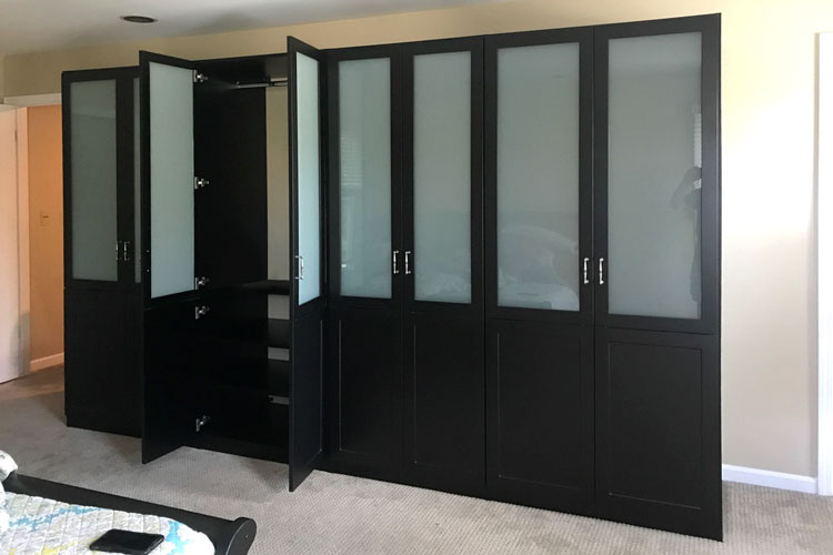 master bedroom wardrobe closet with frosted glass inserts